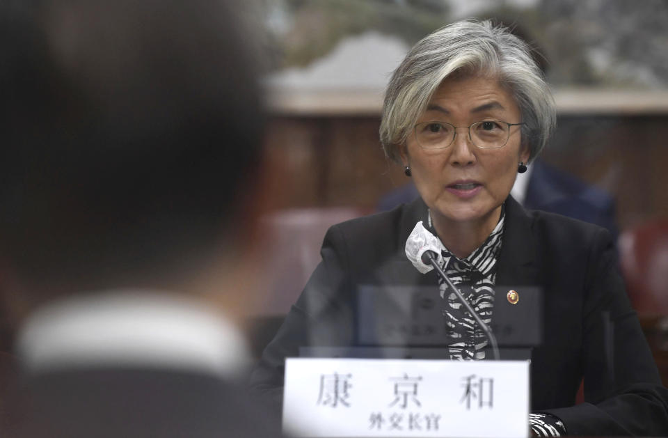 South Korean Foreign Minister Kang Kyung-wha, talks with Chinese Foreign Minister Wang Yi, during their meeting at the foreign ministry in Seoul, South Korea, Thursday, Nov. 26, 2020. Wang arrived in Seoul on Nov. 25, for a three-day state visit.(Kim Min-hee/Pool Photo via AP)