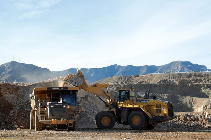 FILE PHOTO: A wheel loader operator fills a truck with ore at the MP Materials rare earth mine in Mountain Pass