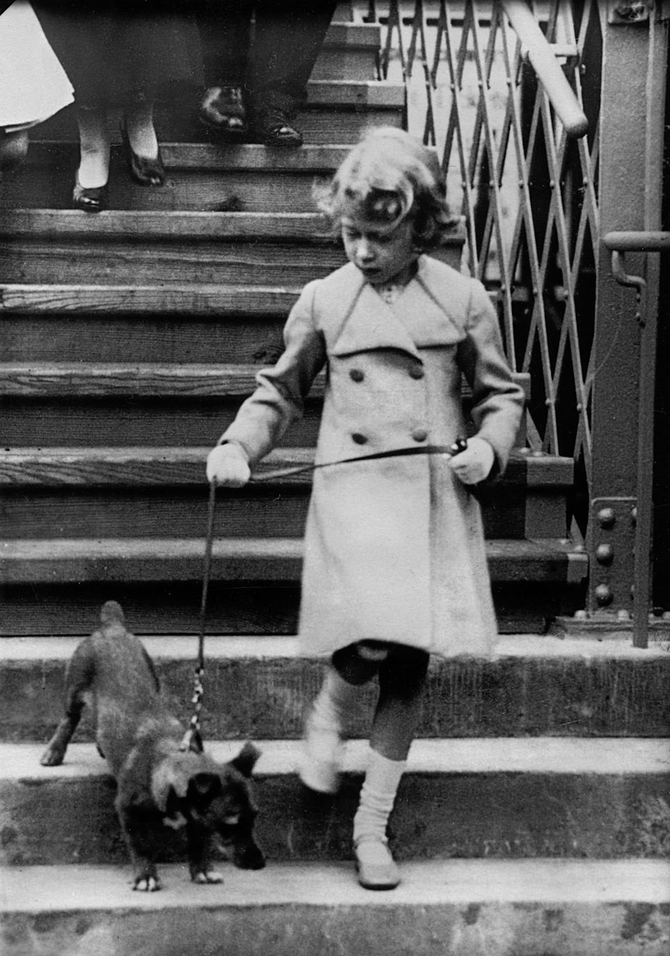 A five-year-old Queen took her dog for a walk in 1931 (Getty Images)