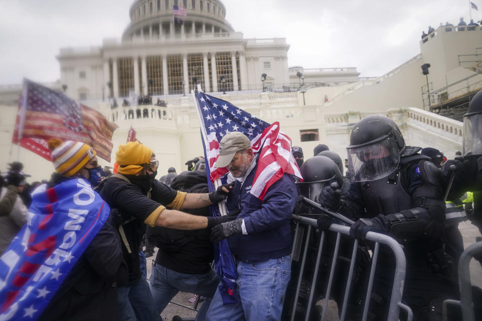 FILE - In this Jan. 6, 2021, file photo rioters try to break through a police barrier at the Capitol in Washington. (AP Photo/John Minchillo, File)