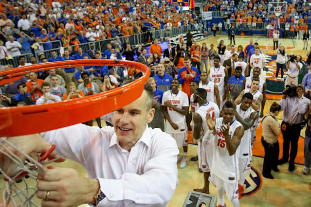 GAINESVILLE, FL - MARCH 08: Head coach Billy Donovan of the Florida Gators cuts off a piece of the net after the game against the Kentucky Wildcats at the Stephen C. O'Connell Center on March 8, 2014 in Gainesville, Florida. The Gators were 18-0 in the SEC Confrence and undefeated at home this season. (Photo by Rob Foldy/Getty Images)