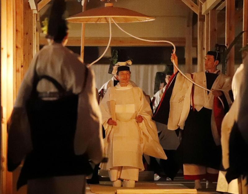 Japan's Emperor Naruhito walks to Yukiden to attend 'Daijosai' at the Imperial Palace in Tokyo