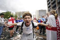 An England fan reacts as crowds gather outside the ground, ahead of the Euro 2020 soccer championship final match between England and Italy, at Wembley Stadium, in London, Sunday, July 11, 2021. (Zac Goodwin/PA via AP)