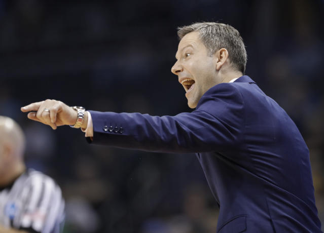 UMBC coach Ryan Odom directs his team against Kansas State during the second half of a second-round game in the NCAA men's college basketball tournament in Charlotte, N.C., Sunday, March 18, 2018. (AP Photo/Gerry Broome)
