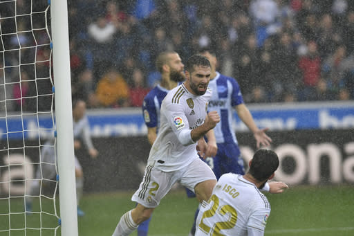 Real Madrid's Dani Carvajal celebrates scoring his side's second goal of the game during the Spanish La Liga soccer match between Real Madrid and Alaves at Mendizorroza stadium, in Vitoria, northern Spain, Saturday, Nov. 30, 2019. (AP Photo/Alvaro Barrientos)