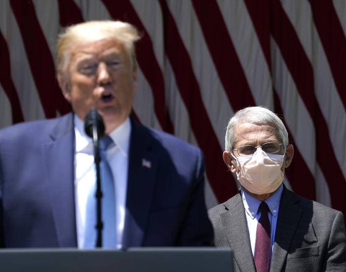 U.S. President Donald Trump is flanked by Dr. Anthony Fauci, director of the National Institute of Allergy and Infectious Diseases while speaking about coronavirus vaccine development in the Rose Garden of the White House on May 15, 2020 in Washington, DC. (Drew Angerer/Getty Images)