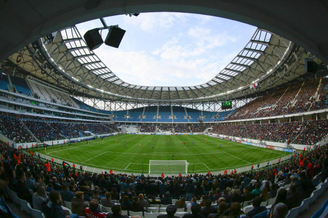 In this photo taken on Saturday, April 21, 2018, a view on the new the World Cup stadium during the Russian league soccer match between Rotor and Luch-Energiya in Volgograd, Russia . The stadium will hold group-stage games at the World Cup. Several of Russias 12 World Cup stadiums look set to be largely empty after the tournament. Its a problem for Russia, which is spending almost $11 billion on the World Cup, and for FIFA. Fans and officials predict more government money will be needed to maintain several stadiums set to host mostly unglamorous lower-league games (AP Photo/Dmitriy Rogulin)