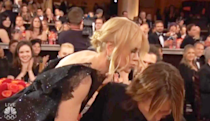 """<p>Hearing her name for Best Actress in a Limited Series in 2018 instantly made Nicole Kidman want to celebrate the moment with husband Keith Urban. But bad timing caused an <a href=""""https://twitter.com/QuinnKeaney/status/950184166087413767"""" rel=""""nofollow noopener"""" target=""""_blank"""" data-ylk=""""slk:awkward exchange"""" class=""""link rapid-noclick-resp"""">awkward exchange</a> between the actress and country singer trying to kiss before getting up on stage. While accepting the Golden Globe win, Nicole also <a href=""""https://www.youtube.com/watch?v=BsHx2dclkLE"""" rel=""""nofollow noopener"""" target=""""_blank"""" data-ylk=""""slk:gave him a shout out"""" class=""""link rapid-noclick-resp"""">gave him a shout out</a>, saying, """"Keith Urban, when my cheek is against yours, everything else melts away and that's love.""""</p>"""