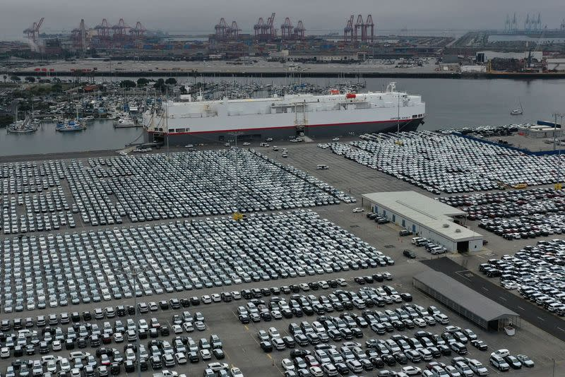 FILE PHOTO: New cars are seen lined up next to the dock as the global outbreak of the coronavirus disease (COVID-19) continues, at the Port of Los Angeles