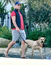 <p>Jon Hamm wears a vest, shorts and flip flops while out walking his dog in L.A. on Wednesday.</p>