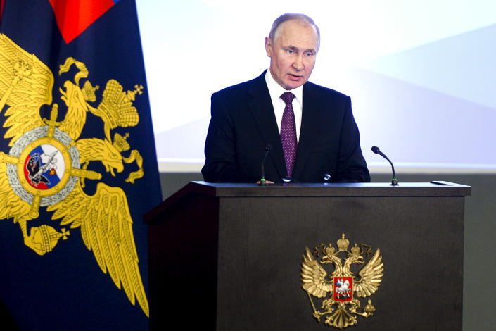 Russian President Vladimir Putin speaks to top Interior Ministry officials in Moscow, Russia, Wednesday, March 3, 2021. Putin urged the Interior Ministry to track down those who draw children to unsanctioned demonstrations. (Sputnik, Kremlin Pool Photo via AP)