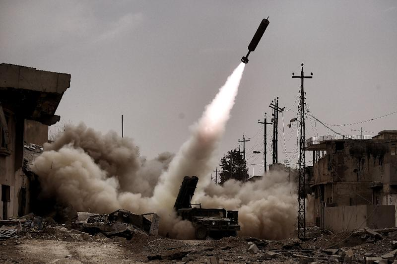 Iraqi troops fire artillery towards Islamic State group positions in west Mosul on March 11 (AFP Photo/ARIS MESSINIS)