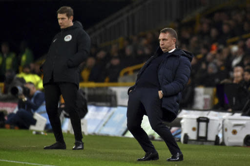 Leicester's manager Brendan Rodgers, right, reacts during the English Premier League soccer match between Wolverhampton Wanderers and Leicester City at the Molineux Stadium in Wolverhampton, England, Friday, Feb. 14, 2020. (AP Photo/Rui Vieira)