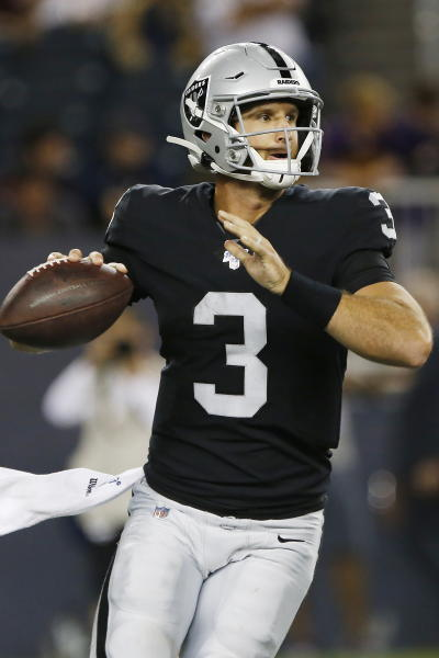 Oakland Raiders quarterback Nathan Peterman looks for a receiver during the second half of the team's NFL preseason football game against the Green Bay Packers on Thursday, Aug. 22, 2019, in Winnipeg, Manitoba. (John Woods/The Canadian Press via AP)