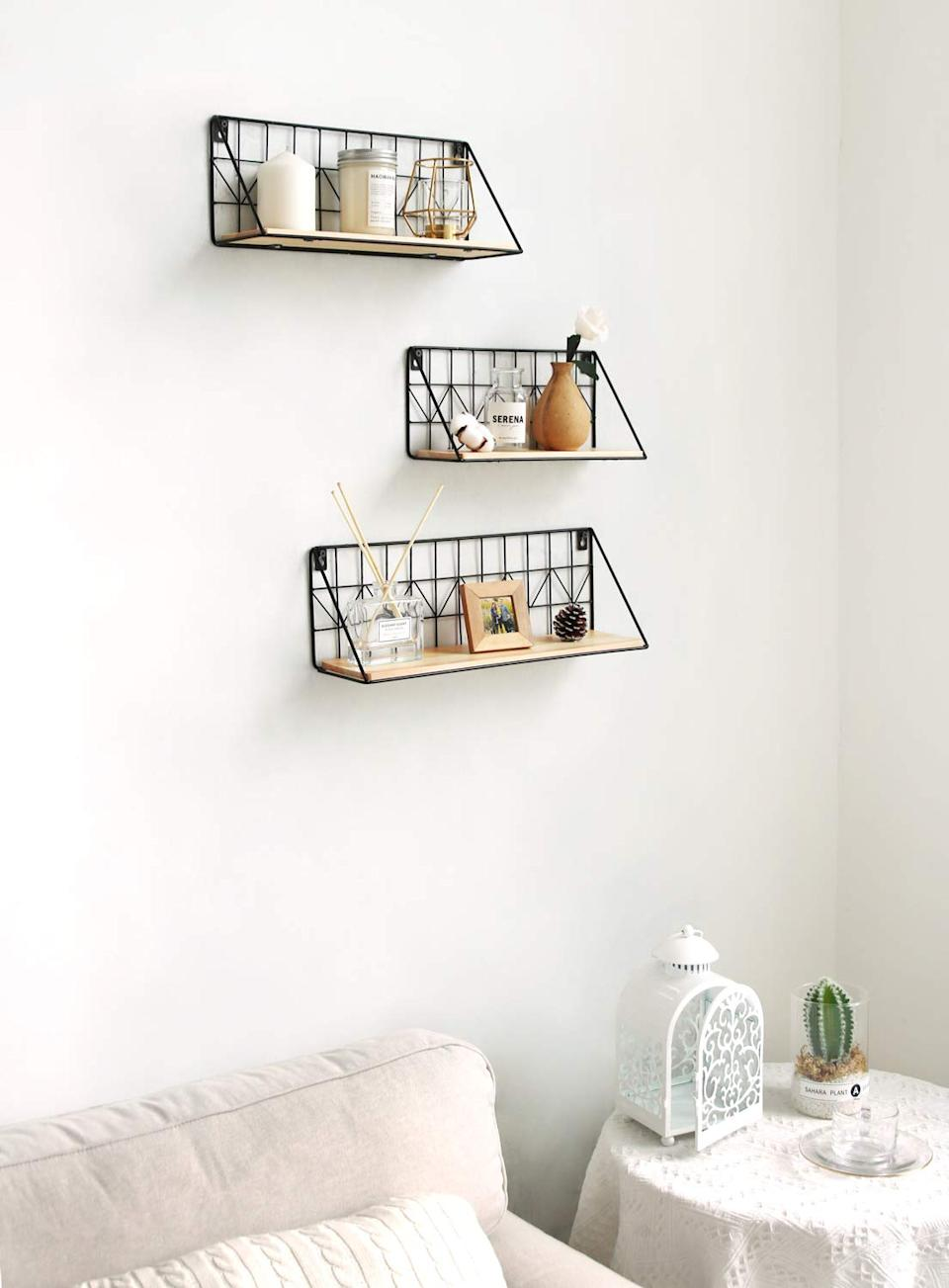 """<h3><a href=""""https://www.amazon.com/Mkono-Mounted-Floating-Shelves-Storage/dp/B07RLBPT52/ref=sr_1_8"""" rel=""""nofollow noopener"""" target=""""_blank"""" data-ylk=""""slk:Metal & Wood Floating Shelf Trio"""" class=""""link rapid-noclick-resp"""">Metal & Wood Floating Shelf Trio</a> </h3><br>Whether you use this shelving trio to display decor or house everyday basics (like beauty products or entryway essentials), its cluster and wall-mountable structures are stylish floor-space saviors.<br><br><strong>Mkono</strong> Wall Mounted Floating Shelves Set of 3, $, available at <a href=""""https://www.amazon.com/Mkono-Mounted-Floating-Shelves-Storage/dp/B07RLBPT52/ref=sr_1_8"""" rel=""""nofollow noopener"""" target=""""_blank"""" data-ylk=""""slk:Amazon"""" class=""""link rapid-noclick-resp"""">Amazon</a>"""