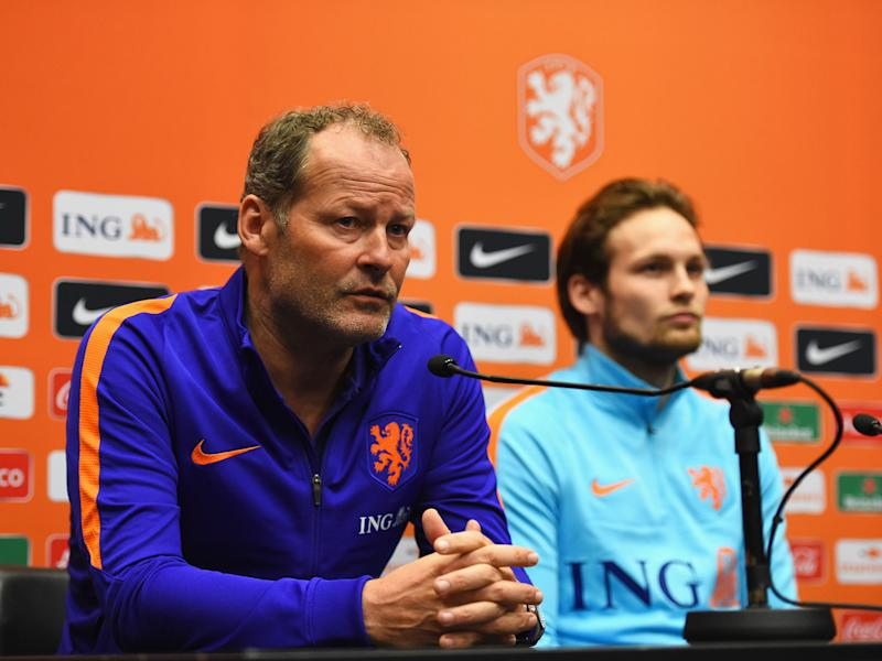 Danny Blind talks to the media alongside Daley Blind: GETTY IMAGES