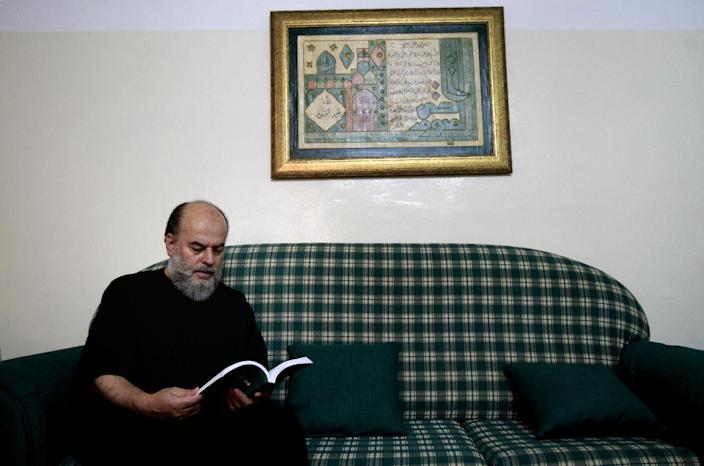 In this Friday, June 21, 2013 photo, Palestinian Bassem Jarrar, a Muslim Sunni scholar, director of noon center for research and Quran studies poses for a photograph at his home in the West Bank city of Ramallah. Hatreds between Shiites and Sunnis are now more virulent than ever in the Arab world because of Syria's brutal civil war. Hard-line clerics and politicians on both sides have added fuel, depicting the fight as essentially a war of survival for their sect. (AP Photo/Majdi Mohammed)