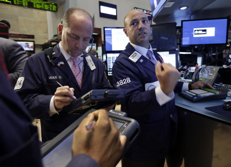 Specialist Frank Babino, right, and trader Michael Urkonis works on the floor of the New York Stock Exchange Wednesday, July 10, 2013. Stocks nudged higher in early trading Wednesday before the Federal Reserve releases minutes from its most recent meeting. (AP Photo/Richard Drew)