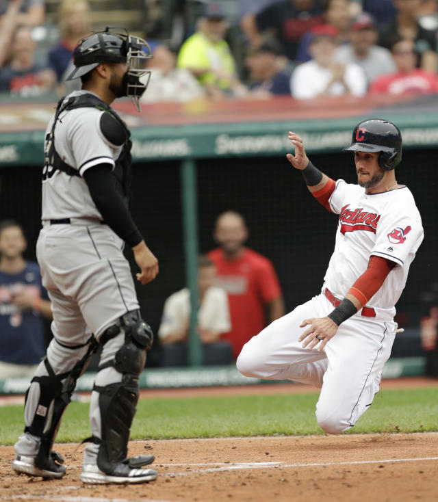 Cleveland Indians' Yan Gomes, right, slides safely into home plate as Chicago White Sox catcher Omar Narvaez watches in the fourth inning of a baseball game, Wednesday, June 20, 2018, in Cleveland. Gomes scored on a single by Rajai Davis. (AP Photo/Tony Dejak)