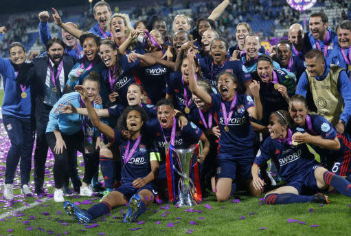 Players from Lyon pose with the trophy after winning the UEFA Women's Champions League Final soccer match between Lyon and Wolfsburg at the Valeriy Lobanovskiy stadium in Kiev, Ukraine, Thursday, May 24, 2018. (AP Photo/Efrem Lukatsky)