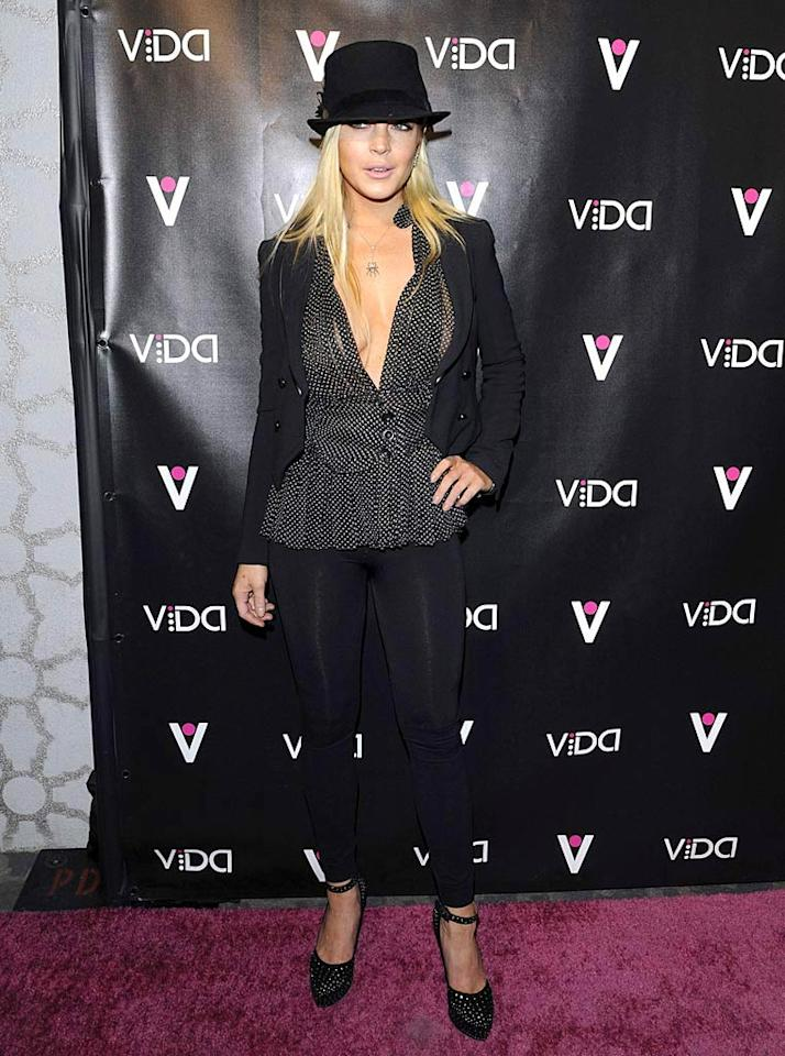 """Lindsay Lohan arrived at Voyeur nightclub in West Hollywood wearing a funky fedora, low-cut polka dot blouse, and her signature leggings. She lives in those things! Jean Baptiste Lacroix/<a href=""""http://www.wireimage.com"""" target=""""new"""">WireImage.com</a> - January 13, 2010"""