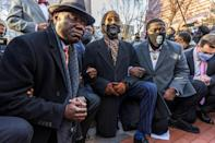George Floyd supporters kneel in protest before the start of the trial of the police officer charged in his death