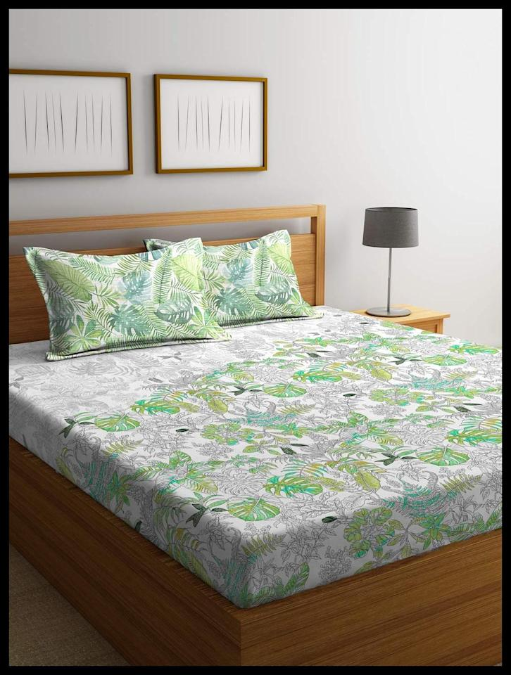 "Add some calming greens to your bedroom with the <a href=""https://www.amazon.in/Portico-New-York-Bedsheet-Multicolour/dp/B07J5SW794/ref=sr_1_2?crid=1FHIQE7T0XH5W&keywords=portico+rainforest&qid=1569579360&s=kitchen&sprefix=portico+rain%2Ckitchen%2C265&sr=1-2"">Rain Forest Bedsheet</a> from Portico New York. King size; includes two pillow covers. 210 TC cotton. <em>Rs. 2,840 on offer.</em>"