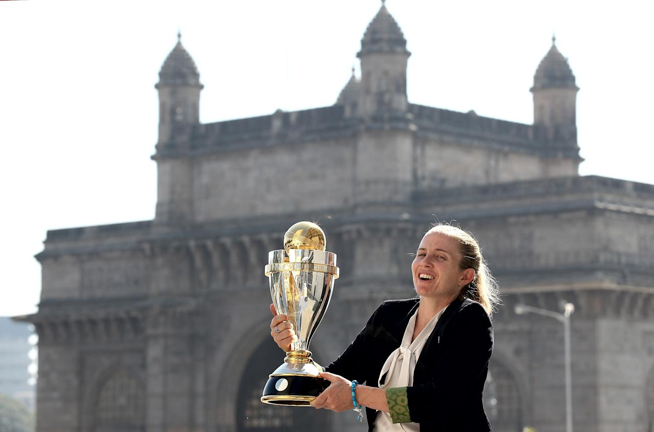 MUMBAI, INDIA - FEBRUARY 18:  Jodie Fields captain of Australia poses with the trophy in front of the iconic Gateway of India monument on February 18, 2013 in Mumbai, India. Australia won in the final between against the West Indies of the ICC Women's World Cup India 2013 played at the Cricket Club of India ground on February 17, 2013 in Mumbai, India. (Photo by Graham Crouch/ICC via Getty Images)
