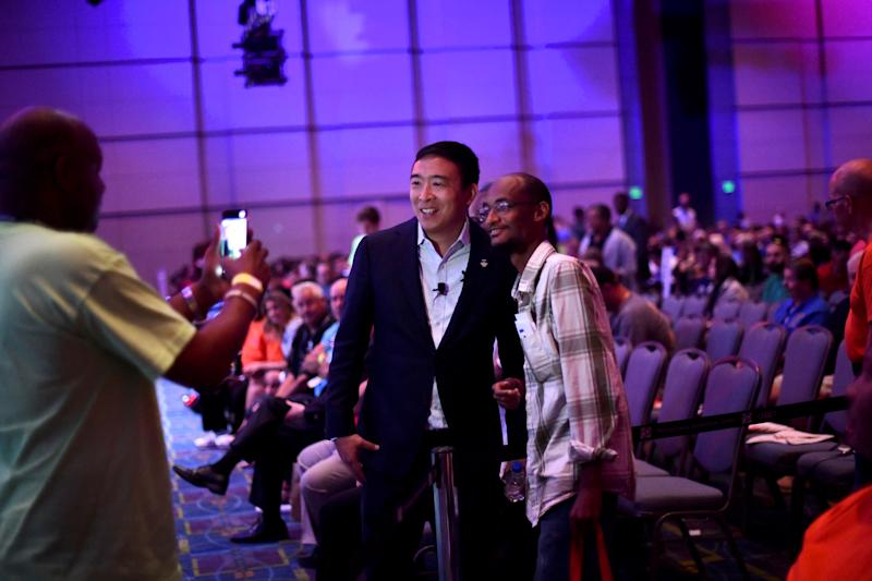 Democratic Presidential candidate Andrew Yang takes pictures with a supporter after speaking during the AFL-CIO Workers Presidential Summit in Philadelphia, U.S., September 17, 2019. REUTERS/Mark Makela