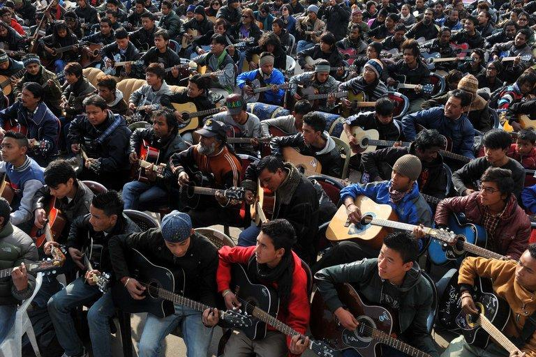 """Musicians play John Lennon's """"Imagine"""" in a memorial tribute to the 23-year old Indian gang rape victim, during a mass guitar ensemble played by some 600 guitarists in Darjeeling on January 3, 2013. Police formally charged five men Thursday with the gang-rape and murder of a 23-year-old student, a crime which appalled India and led to national soul-searching about the treatment of women"""
