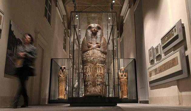 A visitor looks at the sarcophagus of Butehamon at the Museu Egizio (Egyptian Museum) in Turin, the only museum other than the Cairo Museum that is dedicated solely to ancient Egypt art and culture on March 31, 2015. The museum unveiled its expanded and renovated premises on March 31, after being closed for for five years. AFP PHOTO / MARCO BERTORELLO        (Photo credit should read MARCO BERTORELLO/AFP via Getty Images) (Photo: MARCO BERTORELLO via AFP via Getty Images)