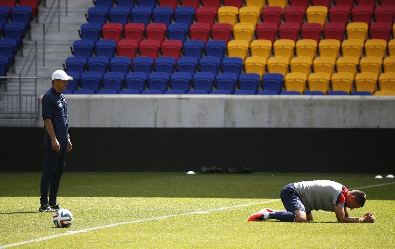 Jurgen Klinsmann, head coach of the U.S. men's national soccer team, looks on as forward Clint Dempsey stretches with his team, during a team training session in Harrison, New Jersey, May 30, 2014. REUTERS/Mike Segar (UNITED STATES - Tags: SPORT SOCCER WORLD CUP)