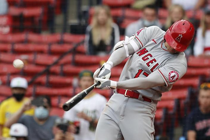 Shohei Ohtani hits a two-run home run during the ninth inning of the Angels' 6-5 win.