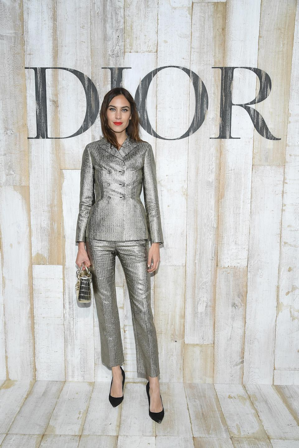 <p>The model showed off her sartorial prowess in a metallic trouser suit paired with a bright lip. <em>[Photo: Getty]</em> </p>