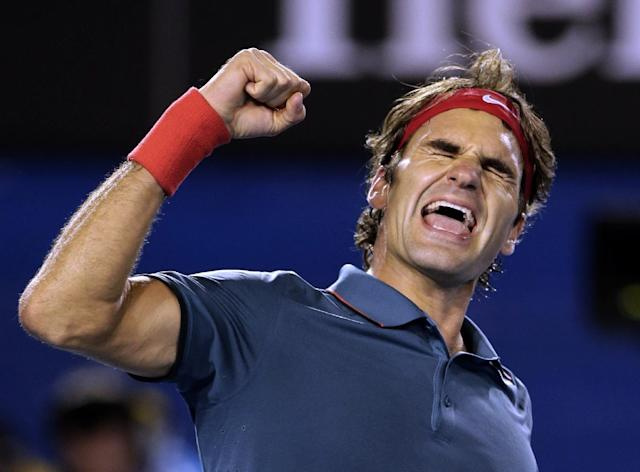 Roger Federer of Switzerland celebrates after defeating Andy Murray of Britain during their quarterfinal at the Australian Open tennis championship in Melbourne, Australia, Wednesday, Jan. 22, 2014.(AP Photo/Rick Rycroft)