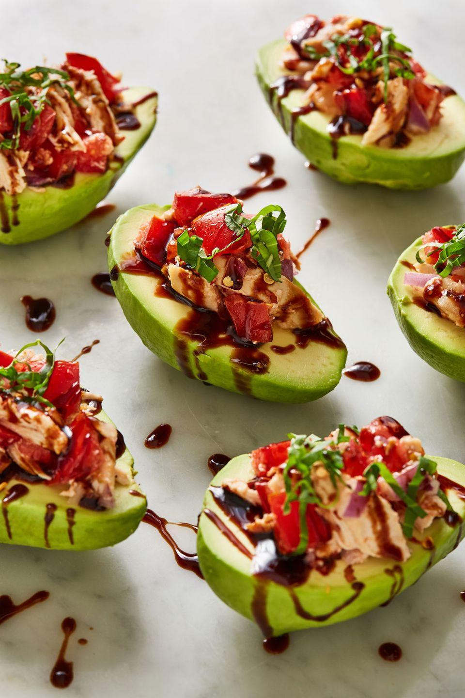 """<p>Low-carb and pretty!</p><p>Get the recipe from <a href=""""https://www.delish.com/cooking/recipe-ideas/a22110065/bruschetta-chicken-stuffed-avocados-recipe/"""" rel=""""nofollow noopener"""" target=""""_blank"""" data-ylk=""""slk:Delish."""" class=""""link rapid-noclick-resp"""">Delish.</a></p>"""