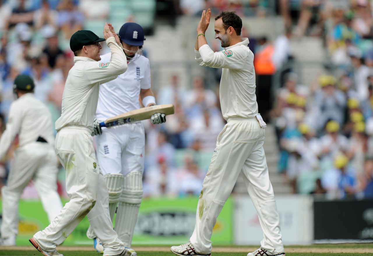 Australia's Nathan Lyon (right) celebrates with Chris Rogers (left) as England's Joe Root is caught behind by Australia's Shane Watson during day three of the Fifth Investec Ashes Test match at The Kia Oval, London.