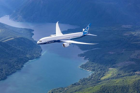 A Boeing 787-9 flying over a river