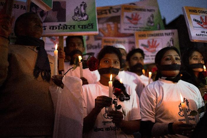 Indian activists take part in a vigil to mark the second anniversary of the fatal gang-rape of a student in New Delhi on December 16, 2014 (AFP Photo/Rebecca Conway)