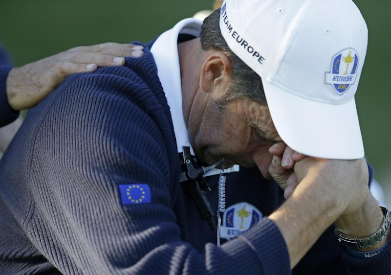 European team captain Jose Maria Olazabal holds his head down on the 17th hole during a singles match at the Ryder Cup PGA golf tournament Sunday, Sept. 30, 2012, at the Medinah Country Club in Medinah, Ill. (AP Photo/Chris Carlson)