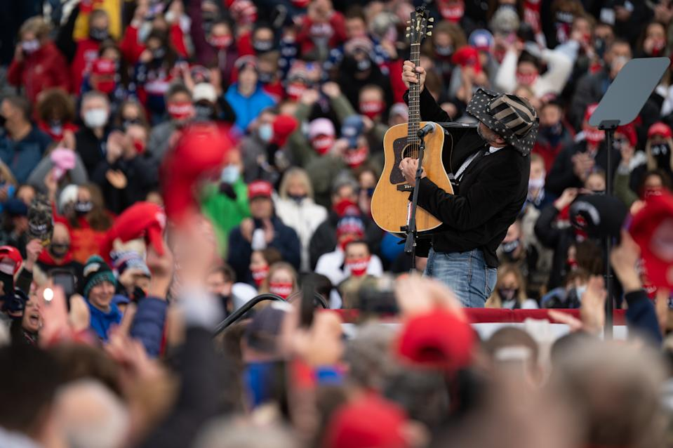 A singer performs the national anthem during a Make America Great Again campaign rally at the Erie International Airport on Wednesday, Oct. 21, 2020 in Erie, PA., United States. (Photo by Noah Riffe/Anadolu Agency via Getty Images)