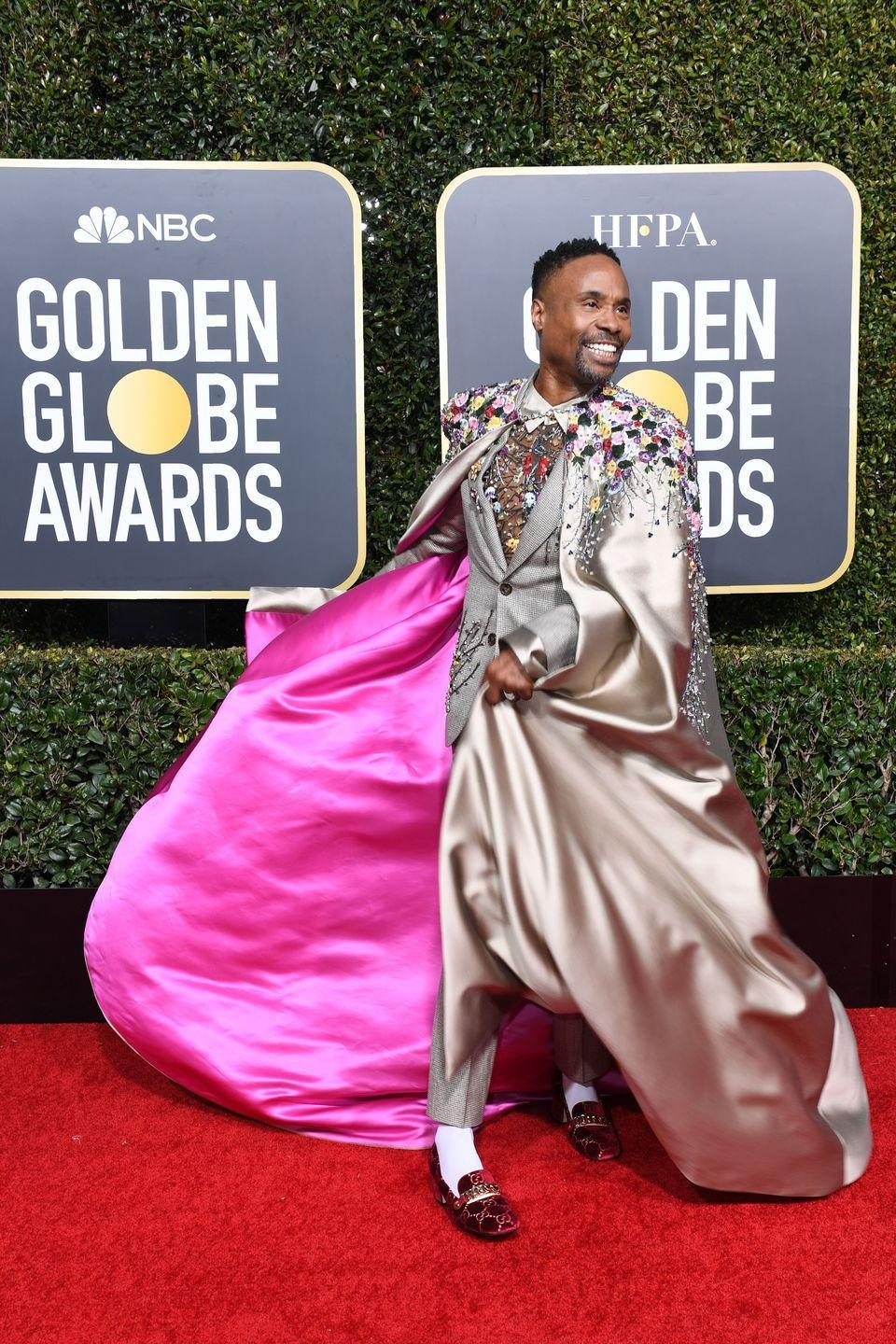 <p>Porter at the 76th annual Golden Globe Awards in a gray suit and cape with floral appliqués, and red velvet loafers by Gucci. </p>
