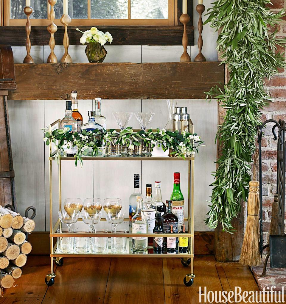 "<p>Bar carts are the one design element that still need to be functional, so make sure <a href=""https://www.housebeautiful.com/entertaining/holidays-celebrations/a4903/bryan-rafanelli-christmas-party/"" rel=""nofollow noopener"" target=""_blank"" data-ylk=""slk:all of your merry-making essentials"" class=""link rapid-noclick-resp"">all of your merry-making essentials</a> fit. Accessorize with greenery and glassware. </p>"