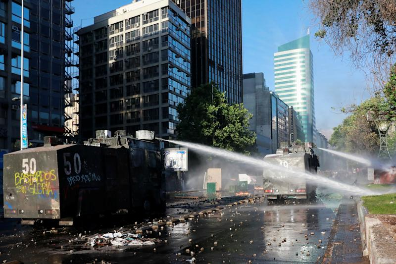 Police water cannons are deployed during an anti-government protest in Santiago, Chile on Oct. 28, 2019. (Photo: Henry Romero/Reuters)