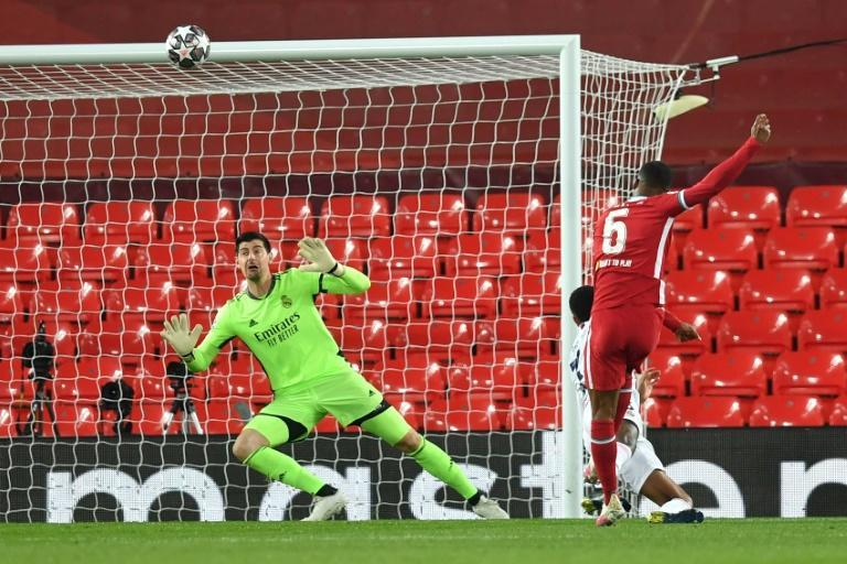 Georginio Wijnaldum (right)blasts over Liverpool's best chance in a 0-0 Champions League quarter-final, second leg draw against Real Madrid