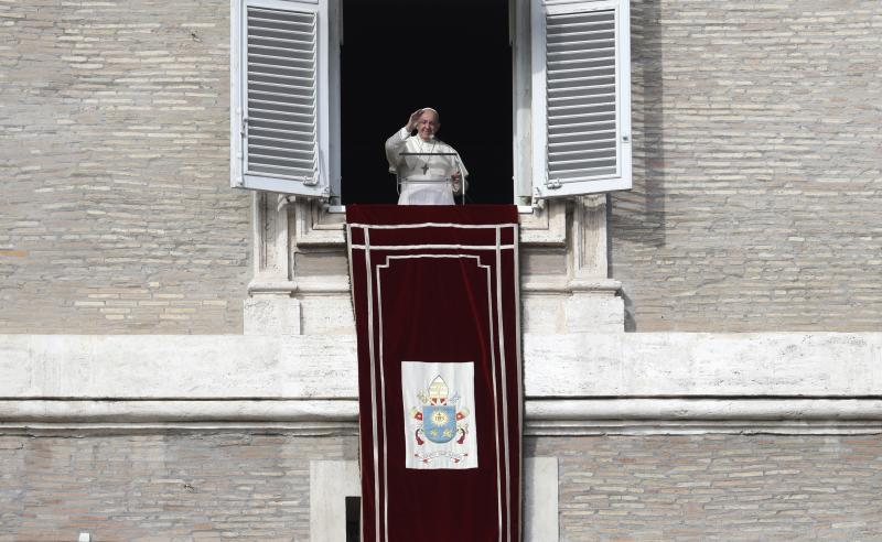 Pope Francis waves during his Angelus prayer from his studio window overlooking St. Peter's Square, at the Vatican, Sunday, Nov. 10, 2019. (AP Photo/Gregorio Borgia)