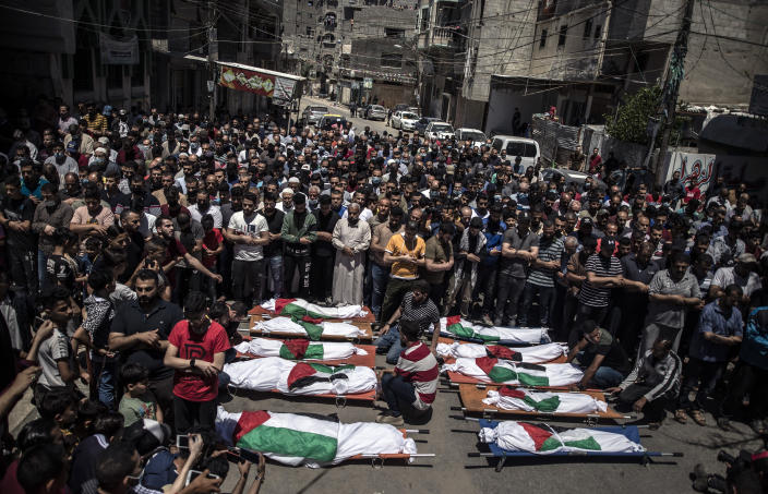 Palestinians attend the funeral of two women and eight children of the Abu Hatab family in Gaza City, who were killed after an Israeli air strike, Saturday, May 15, 2021. (AP Photo/Khalil Hamra)