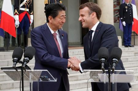 FILE PHOTO: French President Emmanuel Macron and Japan's Prime Minister Shinzo Abe give a joint statement to the media at the Elysee Palace in Paris