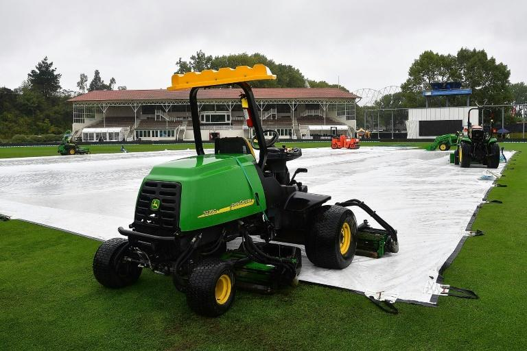 The covers lay over the wicket as rain delays the start of play on day five of the 1st Test match between New Zealand and South Africa, at the University Oval in Dunedin, on March 12, 2017