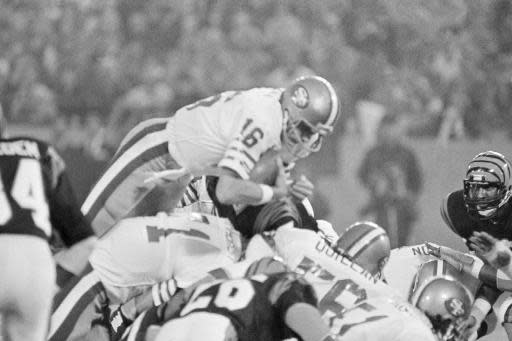 FILE - In this Jan. 24, 1982, file photo, San Francisco 49ers quarterback Joe Montana (16) sneaks across the goal line for the 49ers first score in the first quarter of Super Bowl XVI at the Pontiac Silverdome in Pontiac, Mich. A pair of Super Bowl winning teams that launched dynasties in San Francisco and New England highlighted the list of the NFL's greatest teams, numbers 31-100. Coming in at No. 31 was the 1981 San Francisco 49ers led by coach Bill Walsh and quarterback Joe Montana. (AP Photo/Ray Stubblebine, File)